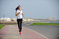 Young beautiful woman jogging on morning and running at park in the city in sport outdoors health and fitness concept Royalty Free Stock Photography
