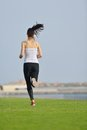 Young beautiful woman jogging on morning and running at park in the city in sport outdoors health and fitness concept Stock Photos