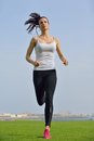Young beautiful woman jogging on morning and running at park in the city in sport outdoors health and fitness concept Royalty Free Stock Photo