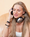 Young beautiful woman listening to music with headphones Stock Images