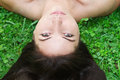 Young beautiful woman, lying on the grass Royalty Free Stock Photos