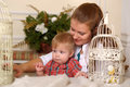 Young beautiful woman mother with her son women next to retro decorative bird cage Stock Image