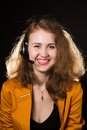 Young beautiful woman operator with headphone smiles it is isolated on black background Stock Photo