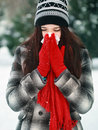Young beautiful woman outdoor blowing nose in winter Stock Photos