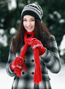 Young beautiful woman outdoor tieying scarf in winter Stock Image