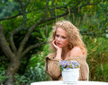 Young beautiful woman posing in the garden Stock Image