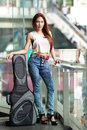 Young beautiful woman posing outdoor with her guitar gig bag model is thai ethnic Royalty Free Stock Photography