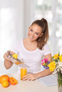 Young beautiful woman pouring orange juice glass sunshine Royalty Free Stock Photos