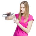 Young beautiful woman pours water into a glass this image has attached release Stock Image