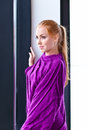 Young beautiful woman in purple jersey Royalty Free Stock Image