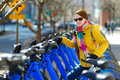 Young beautiful woman ready to rent a city bike in new york usa Royalty Free Stock Photos