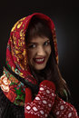 Young beautiful woman in a red traditional Russian shawl on blac Royalty Free Stock Photo