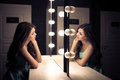 Young beautiful woman and reflection in dressing room Royalty Free Stock Photo