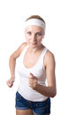 Young beautiful woman runs in fitness wear isolated over background Stock Image