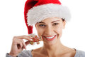 Young beautiful woman in santa hat and a cookie isolated on white Royalty Free Stock Photo