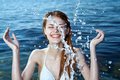 Young beautiful woman in the sea in a bathing suit, splashing, water, summer, fun Royalty Free Stock Photo