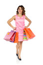 Young beautiful woman with shopping bags isolated on white happy background Stock Image
