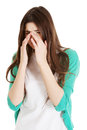 Young beautiful woman with sinus pressure touching her nose isolated on white Stock Images