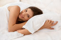 Young Beautiful Woman Sleeping on Bed Royalty Free Stock Photo
