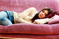 Young beautiful woman sleeping on the sofa at home Stock Image