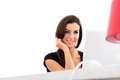 Young beautiful woman smiling while using a laptop at home being cheerful computer Royalty Free Stock Photo