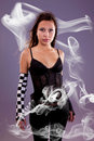 Young and beautiful woman, with smoke effects Stock Photos