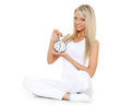 Young sporty woman  with alarm clock. Royalty Free Stock Photo
