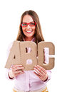 Young beautiful woman standing with abc letters over white background Stock Photo