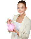 Young beautiful woman standing with piggy bank money box, isolated on white background Royalty Free Stock Photo