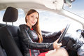 Young beautiful woman steering wheel driving a car Royalty Free Stock Photo