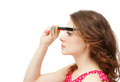 Young beautiful woman with sun glasses in red blouse the goggles isolated on white background Stock Photo
