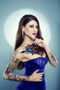 Young beautiful woman with tattoos in blue dress Royalty Free Stock Image