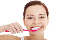 Young beautiful woman with toothbrush and paste isolated on white Stock Images
