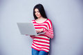 Young beautiful woman typing on the laptop Royalty Free Stock Photo