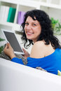 Young beautiful woman using digital tablet and smiling Royalty Free Stock Photos