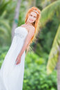 Young beautiful woman in wedding dress on natural backgro Stock Photos
