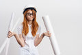 Young beautiful woman on white background holds blueprints, engineering, construction