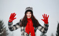 Young beautiful woman in winter outdoor waving Royalty Free Stock Images