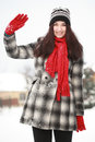 Young beautiful woman in winter outdoor waving Stock Photos