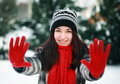 Young beautiful woman in winter showing stop sign Royalty Free Stock Photography