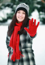 Young beautiful woman in winter showing stop sign Stock Photo