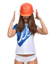 Young beautiful woman yelling screaming in orange construction h Royalty Free Stock Photo