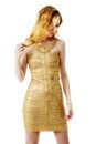 The young beautiful women in a golden dress. Isolation on a whit Royalty Free Stock Photo