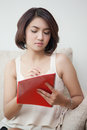 Young beautiful women holding book and pencil Royalty Free Stock Photo