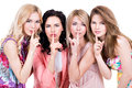 Young beautiful women with silent sign group of posing at studio over on white background Royalty Free Stock Photos