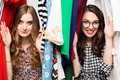 Young beautiful women at the weekly cloth market - Best friends sharing free time having fun and shopping in the old Royalty Free Stock Photo