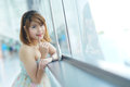Young beautifull woman stand near glass wall in office Stock Photography