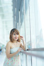Young beautifull woman stand near glass wall in office Royalty Free Stock Photos