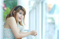 Young beautifull woman stand near glass wall in office Royalty Free Stock Image