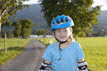 Young beautiul blond girl inline-skating outdoor Stock Photo